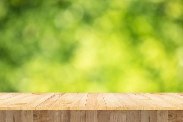 Mostrar producto en blanco mesa publicidad objeto textura verde bokeh fondo