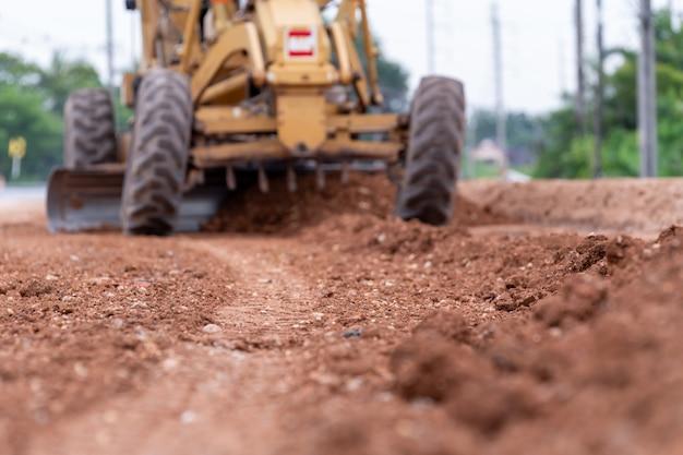 Motoniveladora borrosa obras viales de base de mejora de la construcción de carreteras