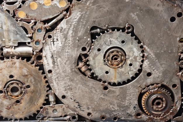 Motor de engranajes de metal. fondo texturizado