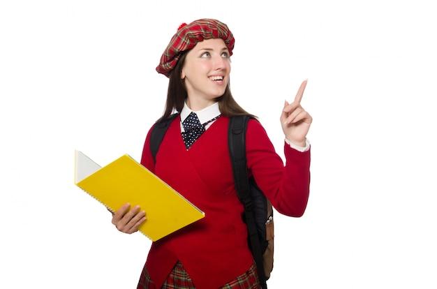 Muchacha en la ropa escocesa del tartán aislada en blanco