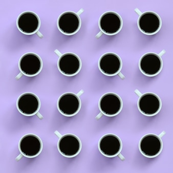 Muchas pequeñas tazas de café blanco sobre fondo de textura