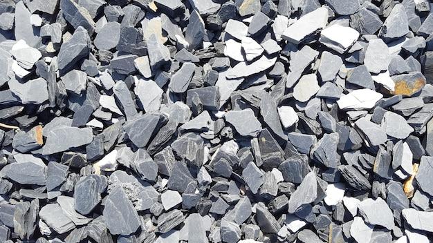 Muchas piedras grises como la textura del fondo de diferentes formas