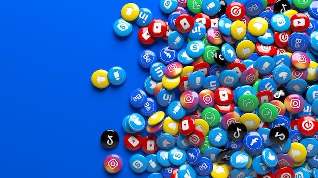 Muchas píldoras de redes sociales sobre un azul sólido. un montón de píldoras brillantes de red social multicolor 3d sobre un fondo azul.