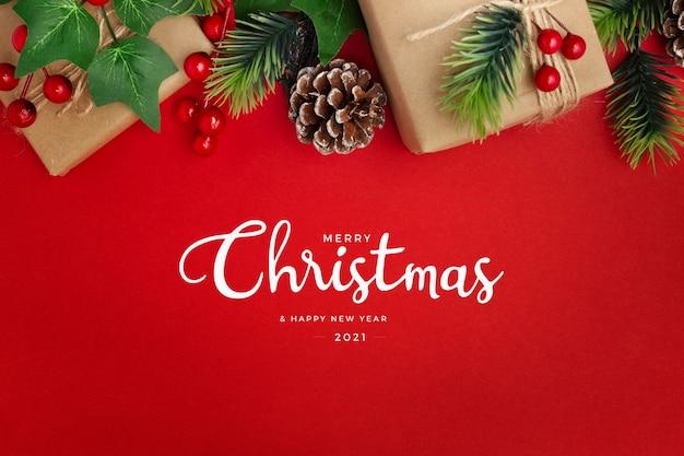Muérdago, piñas y regalos en el cuadro rojo saludo de navidad