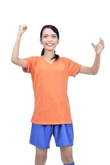 Mujer asiática salida del jugador footbal con la expresión del ganador