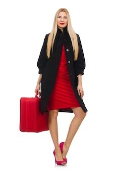 Mujer bastante rubia que sostiene la maleta aislada en blanco