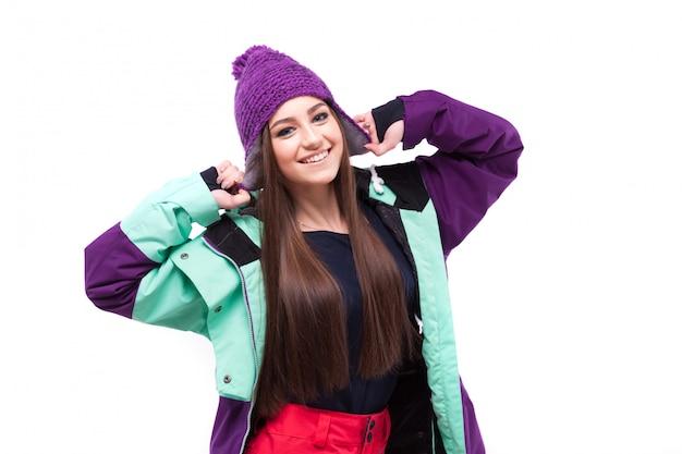 Mujer de belleza en traje de esquí de pelo largo