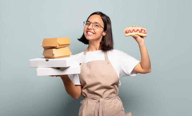 Mujer bonita joven chef. concepto de comida rapida