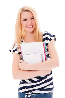 Mujer estudiante, tenencia, cuadernos