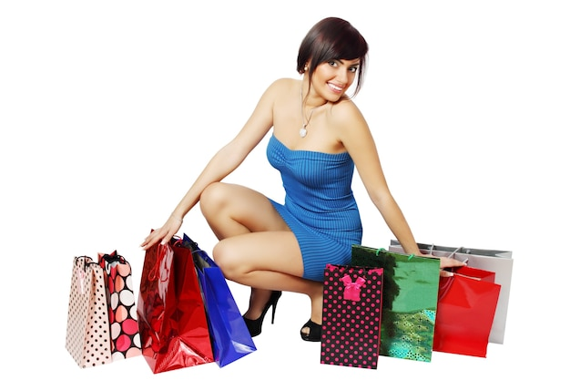 Mujer feliz y muchas bolsas de la compra.