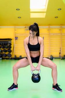 Mujer en el gimnasio