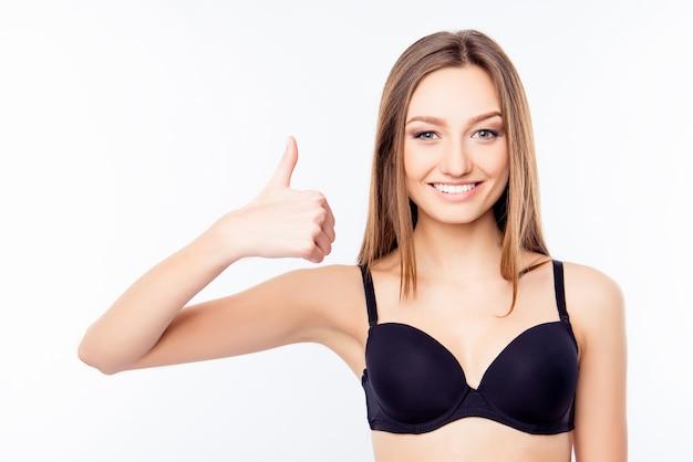 Mujer joven, en, sujetador negro, pulgares arriba