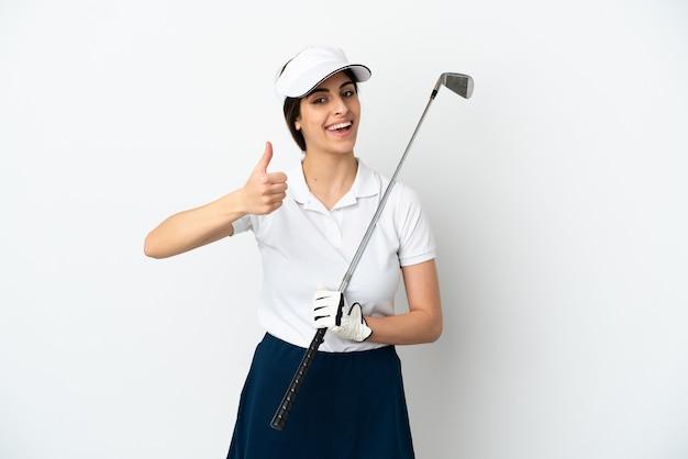 Mujer de jugador de golfista joven guapo aislada sobre fondo blanco con los pulgares hacia arriba porque algo bueno ha sucedido