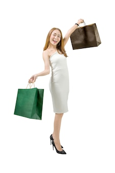 Mujer de lujo bastante asiática con bolsas de compras