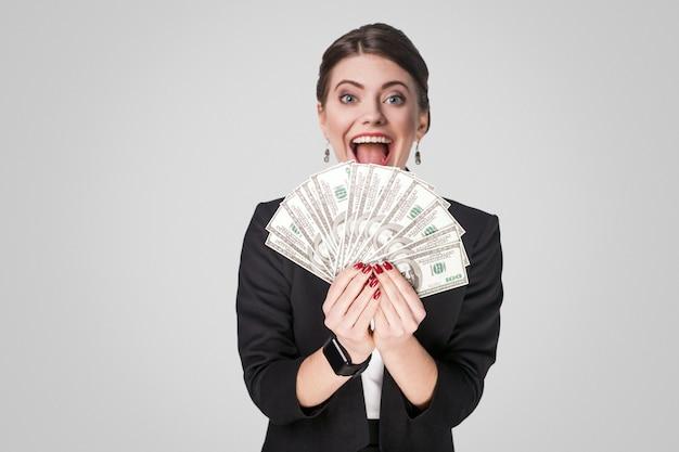 Mujer de negocios, actuación, en, efectivo, dólar