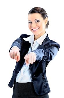 Mujer de negocios agradable señalando con el dedo aislado sobre un fondo blanco.
