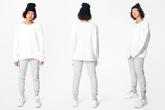 Mujer en suéter básico blanco con conjunto de cuerpo completo de ropa casual de espacio de diseño