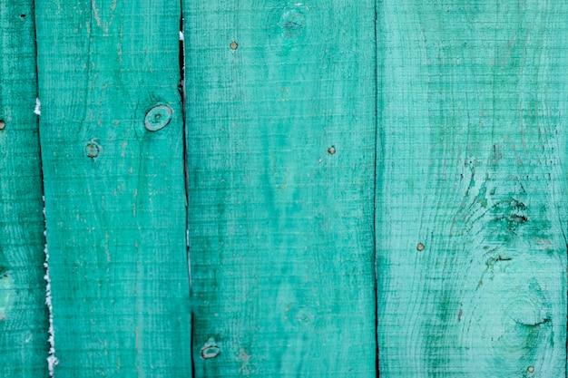 Multa de panel de madera verde vintage dispuesta como pared
