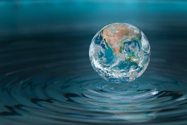Mundo cayendo en una gota de agua, concepto para la depilación del agua y conservador.