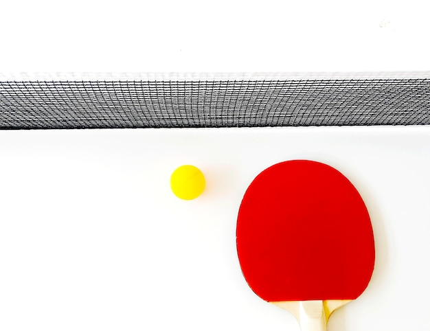 Murciélago rojo de tenis de mesa