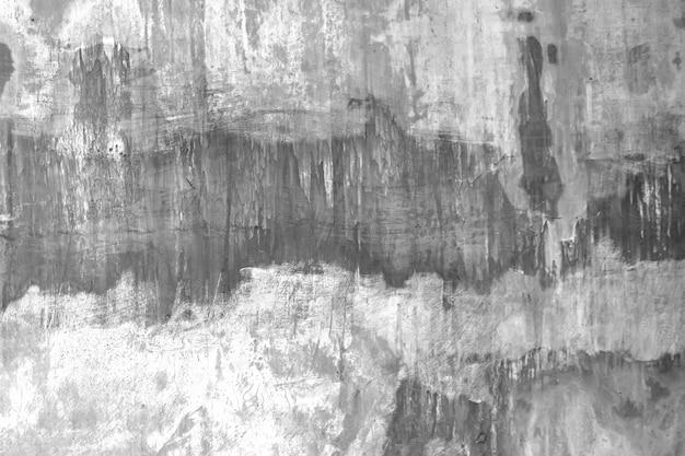 Muro de cemento u hormigón o yeso viejo crudo con manchas y grietas de fondo y textura.