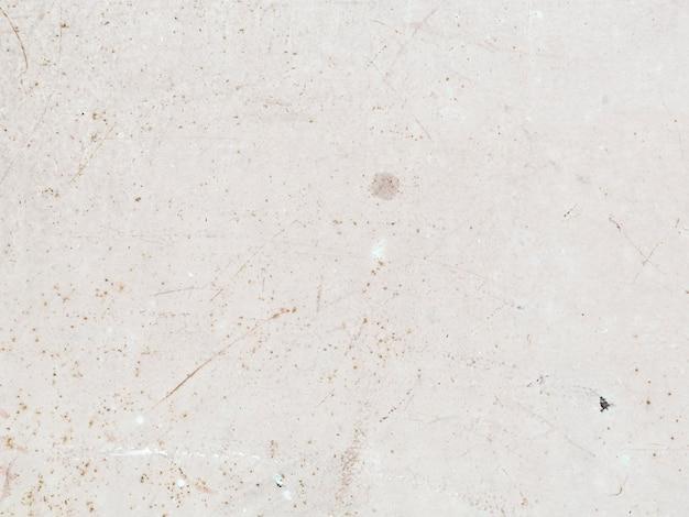 Muro de hormigón blanco moteado con textura