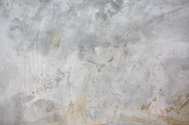 Muro de hormigón con fondo de textura superficial de arañazos.