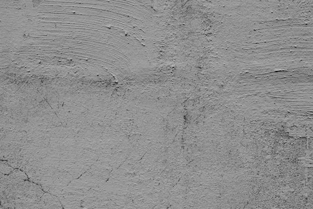 Muro de hormigón con grietas y arañazos