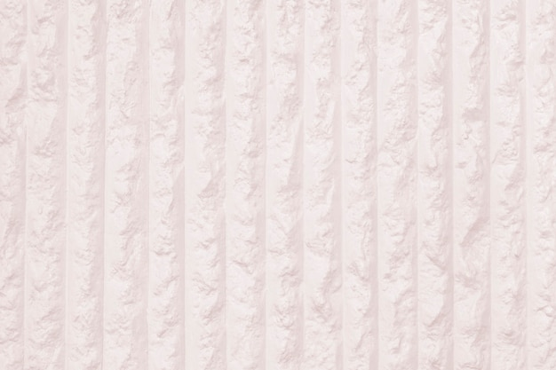 Muro de hormigón rayado rosa pastel con textura