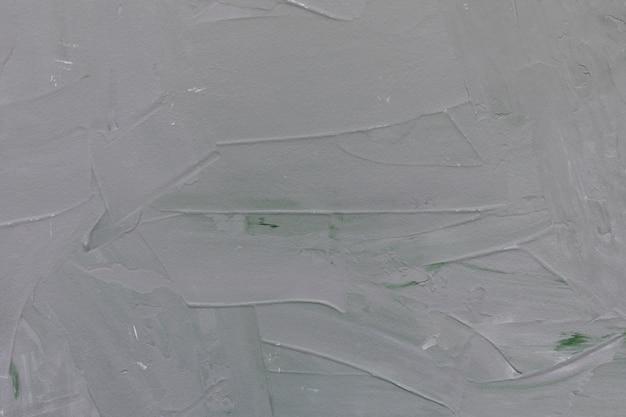 Muro de hormigón rugoso gris claro y verde o pared de textura de estuco