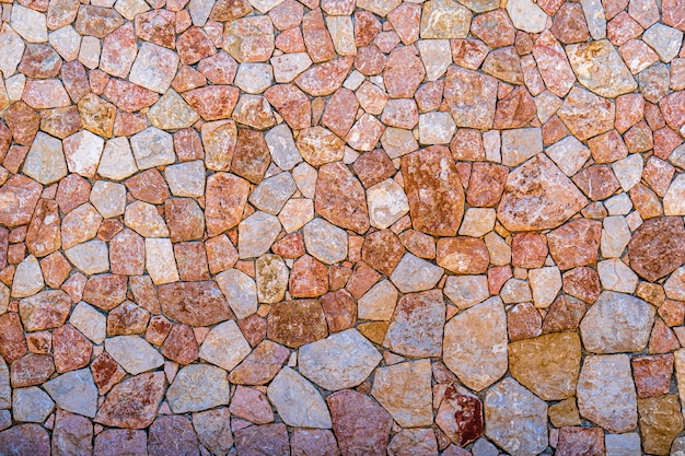 Muro de piedra de mármol púrpura y rosa textura closeup superficie grunge mampostería rock antiguo patrón
