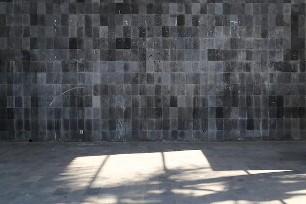 Muro de piedra oscura para el fondo