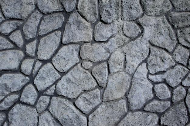 Muro de piedras de diferentes tamaños y formas irregulares. fondo. textura.