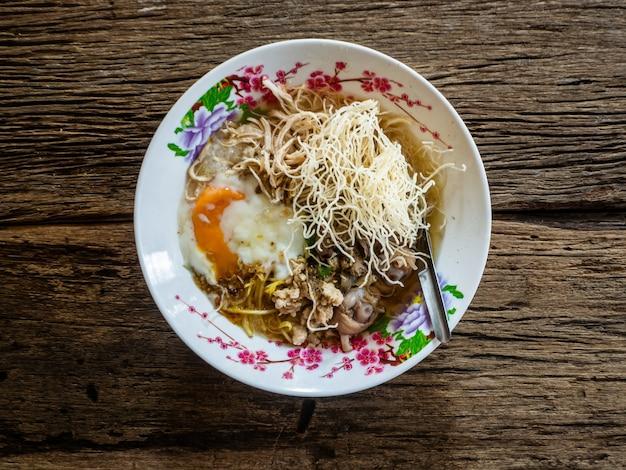 Mush arroz en madera, comida de tailandia