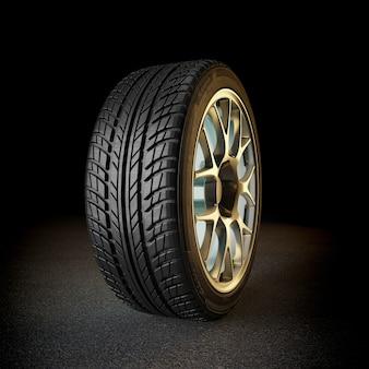 Neumático con llanta dorada.