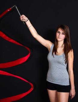 Niña con cinta artística de gimnasia