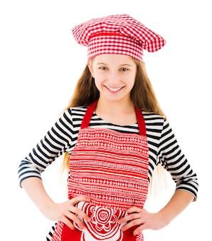 Niña en rojo chef uniforme sonrisas