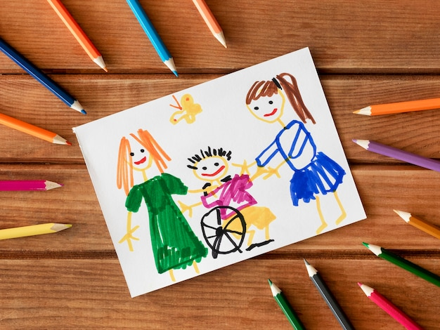 Niño discapacitado y amigos dibujados con lápices