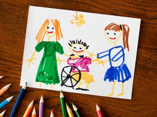 Niño discapacitado y amigos laicos planos