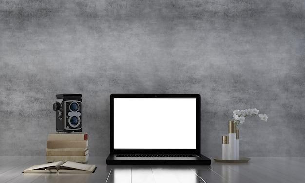 El nuevo espacio de trabajo normal y computadora portátil y cámara vintage y concreto