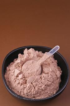 Nutrición deportiva. proteína en polvo para cócteles. espacio libre para texto. copia espacio