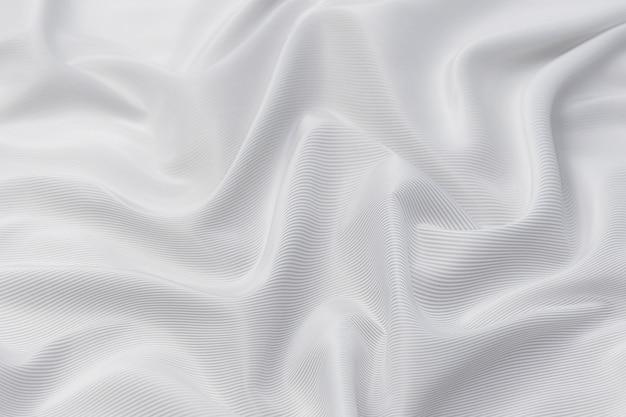 Onda abstracta y de enfoque suave de fondo de tela blanca, textura blanca y detalle