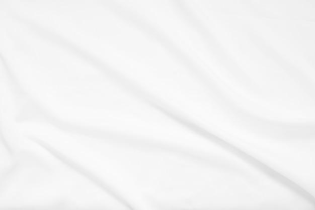 Onda de enfoque abstracto y suave de fondo de tela blanca, textura blanca y detalle