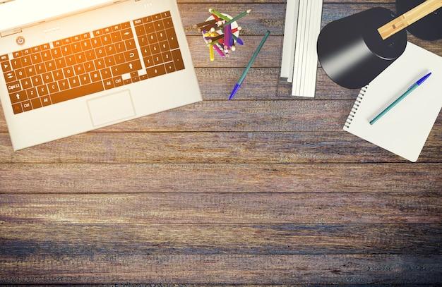 Ordenador portátil con vista superior en la mesa de trabajo con espacio de copia, representación 3d
