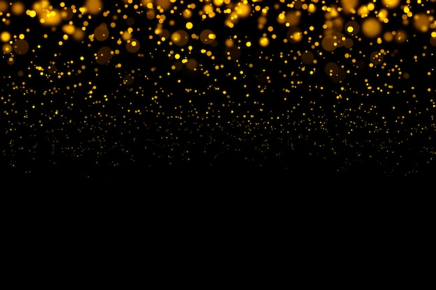 Oro brillante luz bokeh partículas abstractas en fondo oscuro.
