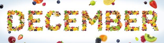 Palabra de diciembre hecha de frutas tropicales y exóticas