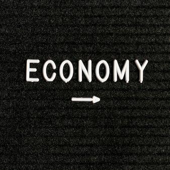 Palabra de economía y flecha puntiaguda