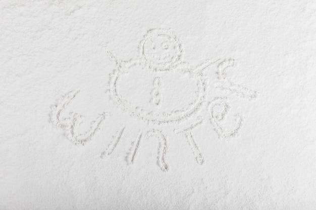 Palabra de invierno en superficie de nieve