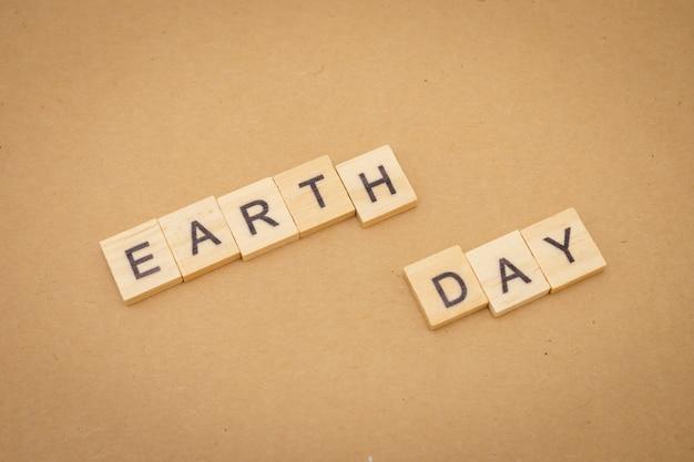Palabra de madera, día de la tierra, como fondo concepto del día universal y concepto del día de la tierra