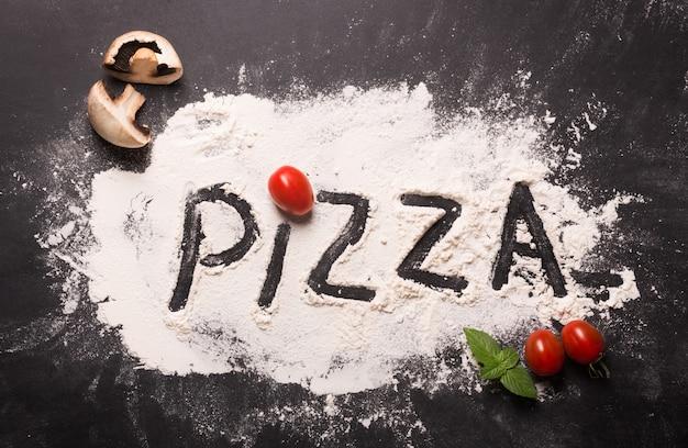 Palabra de pizza en harina con ingredientes
